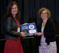 Mary Ann Sondrini of the Eagleson Institute presenting the Eagleson Lecture Series Award to Hazel Barton, PhD, 2017 ABSA International Conference