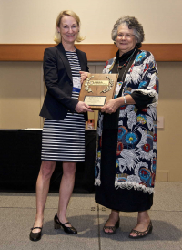Maureen O'Leary, PhD, MBA, CBSP, presenting the Everett Hanel, Jr. Presidential Award to Dee Zimmerman, 2017 ABSA International Conference