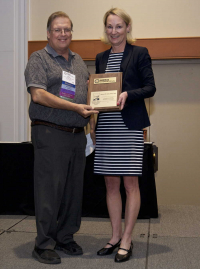 Maureen O'Leary presenting the Arnold G. Wedum Distinguished Achievement Award to Rebar, Richard, RBP, CBSP, 2017 ABSA International Conference