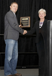 Janet Peterson, CBSP, presenting the Richard C. Knudsen Publication Award to David Pawlowski , 2017 ABSA International Conference